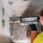 Zander employee injecting crack solution